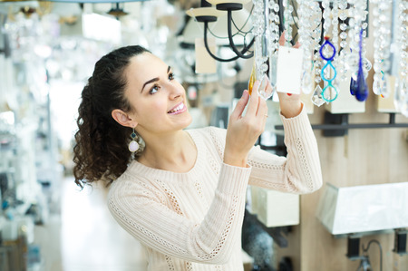 spanish woman: Ordinary spanish woman doing shopping in lighting shop