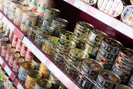 tinned goods: BARCELONA, SPAIN - FEBRUARY 02, 2016: Shelves with ordinary assortment of tinned and canned products in East European food store