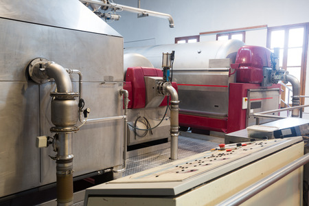 Grape pressing and crushing machines in wine plant