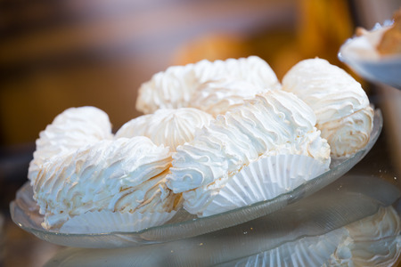 confectionary: Tasty white meringue at confectionary display of coffee-house