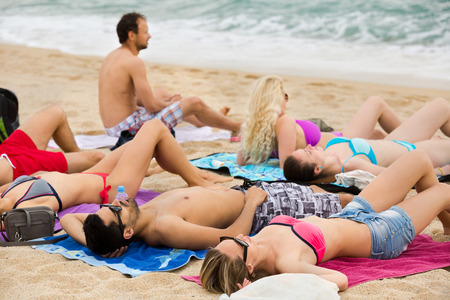european people: Young european people sunbathing on the beach