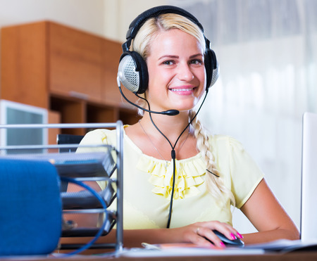 Portrait of smiling call center operator in office