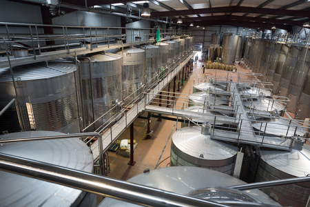 stell: Rows of contemporary stell barrels in winemake