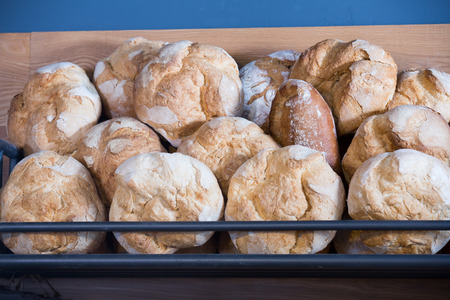 Newly-baked scones and buns in modern bakery