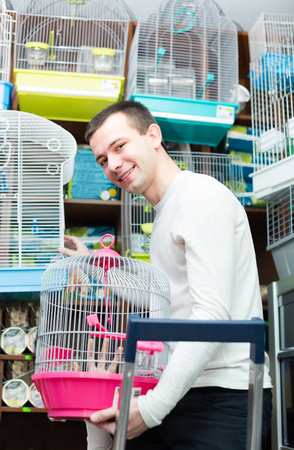 19's: american young couple purchasing bird cage in petshop