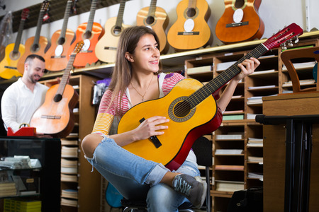 ordinary: Portrait of european ordinary customers  in music instruments shop Stock Photo