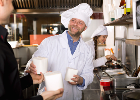 satisfied customer: Portrait of satisfied customer, chef and cook at fastfood place Stock Photo