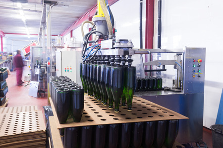 tagging: Automatical bottle sealing and labling assembly line at wine plant