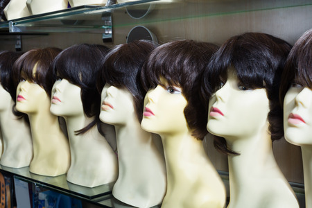 peruke: Dummies heads with modern hair style periwigs at a shop Stock Photo
