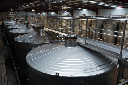 stell: Closeup of equipment of contemporary winery with  stell barrels