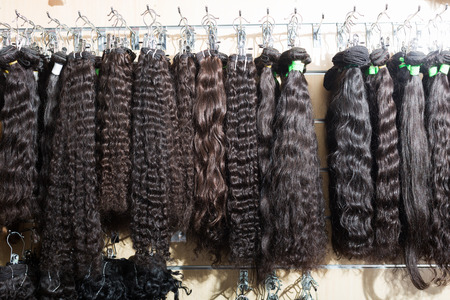 Assortment of beauty human hair extensions in salon