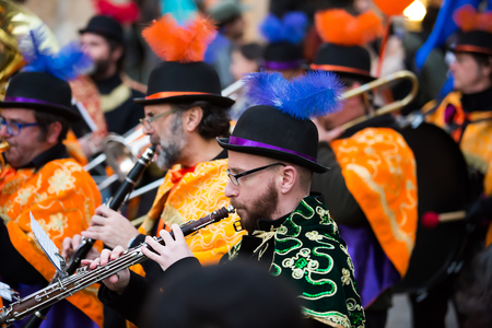 mummery: BARCELONA, SPAIN - FEBRUARY 4, 2016:  Musicians at Spanish Carnaval at Barcelona in evening time.   Spain Editorial