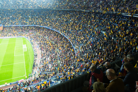 fandom: BARCELONA, SPAIN - NOVEMBER 04, 2015: Above view at field and audience during football game between FC Barcelona and FC BATE Borisov (Belarusian) on Nou Camp stadium.