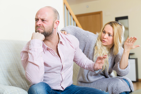 jackboot: Casual angry family having quarrel in livingroom at home Stock Photo