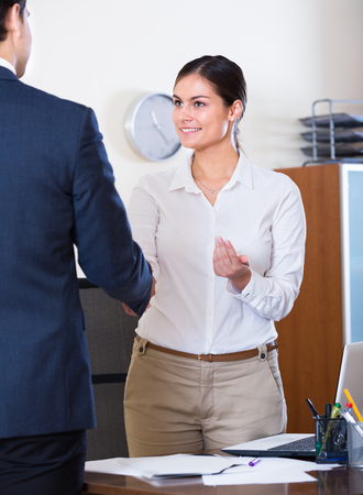 recruit help: Manager greeting new caucasian employee and smiling in office