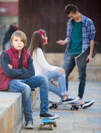 16s: Jealous russian teen and his friends after conflict outdoors Stock Photo