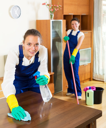 houseman: Smiling adult female workers cleaning company ready to start work