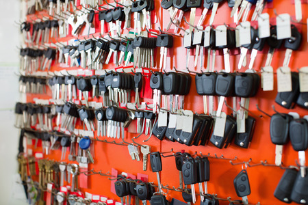 Assortment of car key duplicates at display in locksmith Stok Fotoğraf