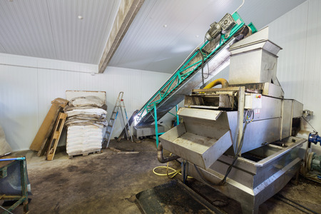 enginery: Closeup of washing and crushing olive devices at industry