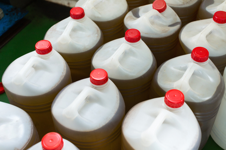 litre: Group of filled with olive oil plastic containers