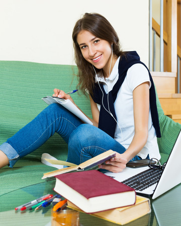 armenian woman: Smiling young female college student study at home