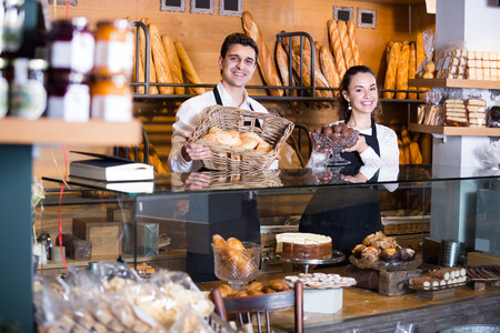 smock: Smiling cooks selling tarts and sweet pastry in bakery