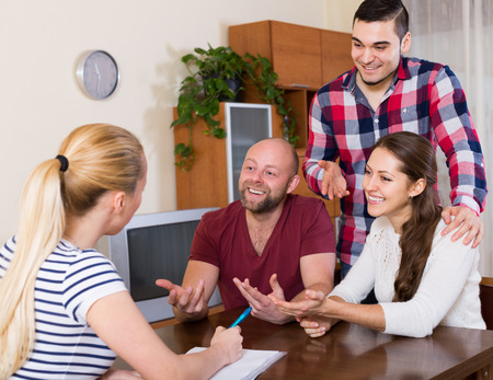 spouses: Young spouses sitting with documents and asking american friends for advice