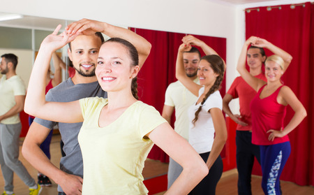 unprofessional: Group of young russian people dancing salsa in studio Stock Photo
