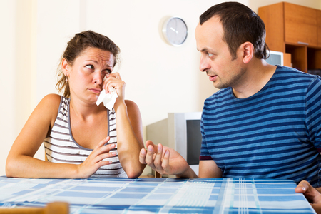 sorting out: Young unhappy family sorting out their relationship