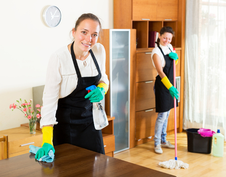 houseman: Cheerful women workers cleaning company ready to start work