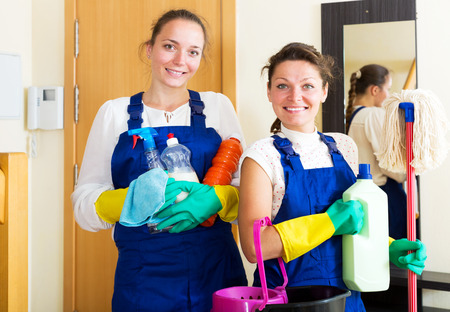company premises: Female workers cleaning company ready to start work