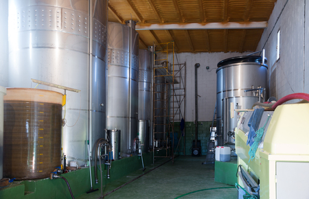 stell: Small contemporary  winery factory with  stell barrels
