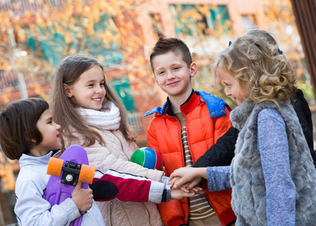 vow: Positive children holding hands and giving friendship vow Stock Photo