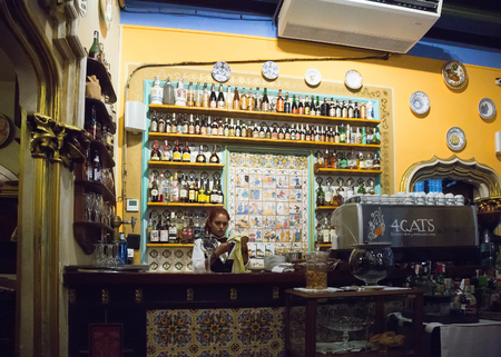 els: BARCELONA, SPAIN - SEPTEMBER 09, 2015: Bar counter in interior of cafe Els Quatre Gats (Catalan for The Four Cats), Catalonia