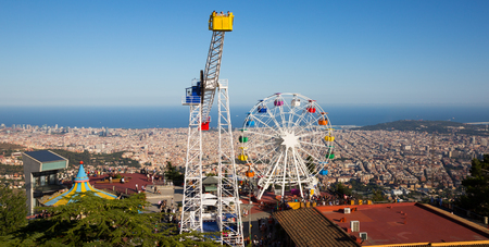 lasted: BARCELONA, SPAIN - AUGUST 29, 2015:  Amusement Park at Tibidabo  in Barcelona, Spain.  Park is oldest amusement park in Spain.?hurch dedicated to Sacred Heart, lasted from 1902 to 1961 Editorial