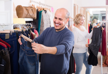 spouses: happy american spouses buying pair of classic jeans in boutique
