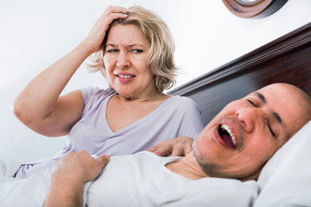 evil woman: Mature aweary evil woman disturbed with partner snores continiously