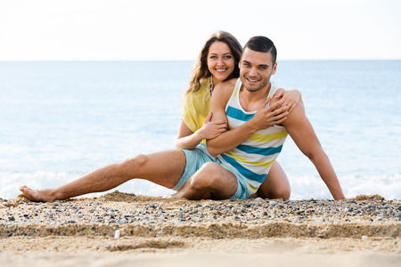 twosome: loving twosome having romantic date on sandy beach at sunny day Stock Photo