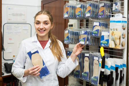 orthopaedic: Orthopedist selling comfortable orthopaedic insoles in store