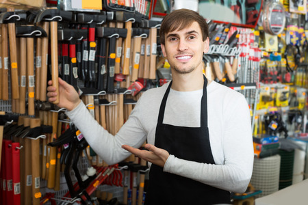 tooling: adult male seller posing at tooling section of household store Stock Photo