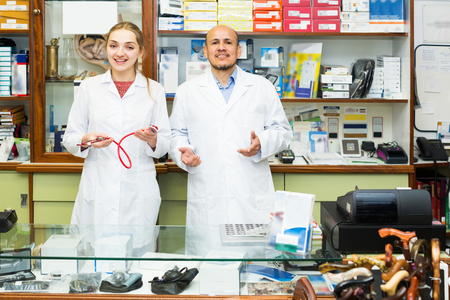 orthopaedic: Friendly professional physicians offering orthopaedic goods in store Stock Photo
