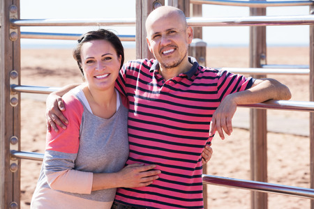wall bars: Man and woman standing together close to wall bars and smiling