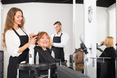 hairstylists: Portrait of  smiling senior mature woman at the hairstylist?s studio Stock Photo