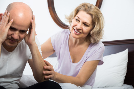 remit: Mature european  wife warmly comforting upset husband in bedroom