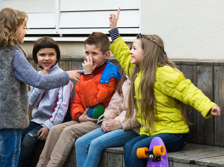 guess: Positive kids trying to guess what friend shows in charades
