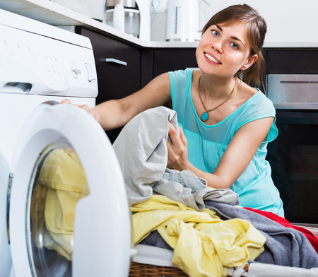 without clothes: Positive woman enjoying clean clothes without stains after laundry Stock Photo