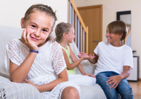 amorousness: First amorousness:  spanish girl and couple of kids apart indoors