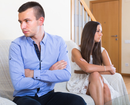 sulking: Young couple sulking on each other during quarrel at home Stock Photo
