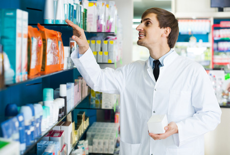 farmacy: Portrait of positive male pharmacists working in modern farmacy