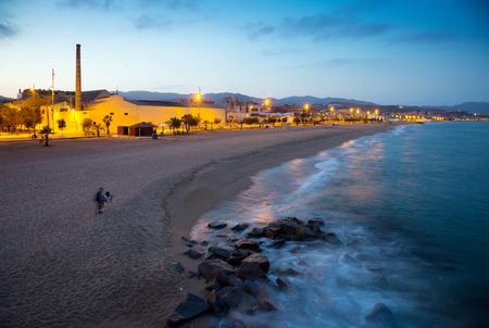 fabrica: beach of Badalona in twilight time. Catalonia
